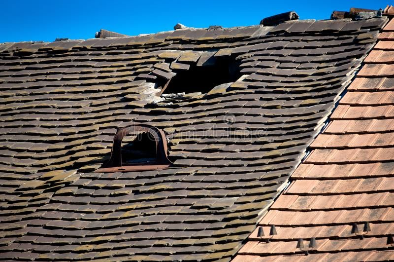 Old Damaged Tiled Roof With A Hole On The Roof And Broken Tiles Old Damaged Til Aff Roof Tiled Damaged T Cool Roof Best Roofing Company Roof Repair