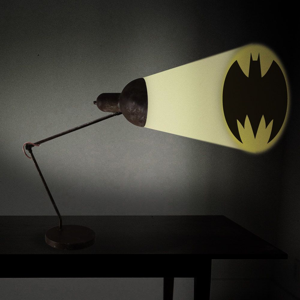 Cut out any shape and tape it over the mouth of the lamp shade and create your own shadow art.