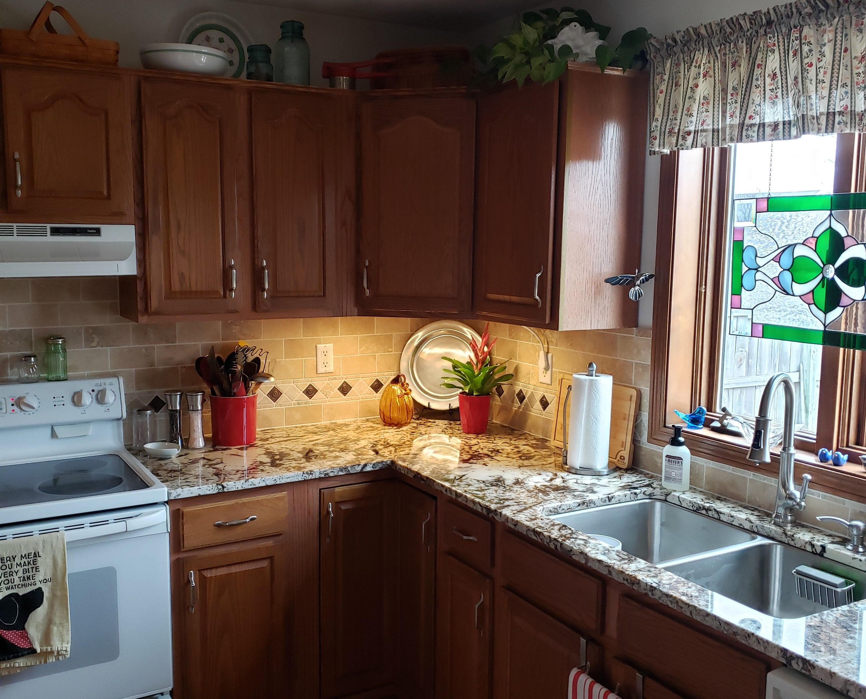 Updated kitchen keeping the oak cabinets and white ...
