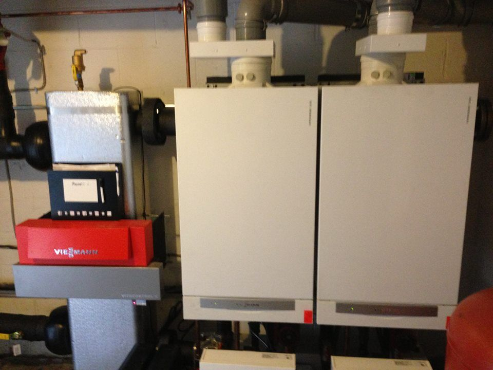 This System Is The Veissmann Vitodens 200 W Gas Fired Wall Mounted Condensing Boiler With Modulating Stainless Locker Storage Basement Remodeling Steam Boiler