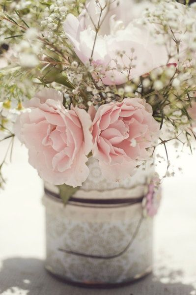 This was Mama's style:   Buckets filled with pink roses and baby's breath. Watered with dew, fed with love