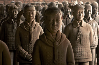 """An artist creates """"Terracotta Daughters"""" in protest of China's preference for male children."""