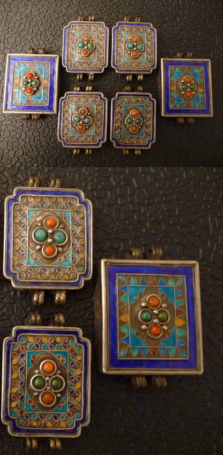 Mongolia | Enamelled pendants, decorated with coral and turquoise | ca. late 19th to early 20th century | Private collection