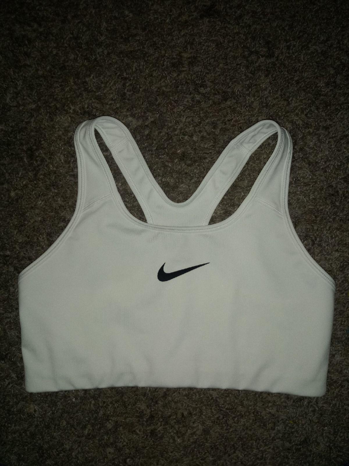 Womens size Large Nike DriFit bra. White with black logo