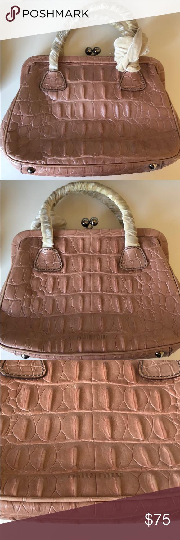 Miu Miu vintage blush pink crocodile handbag Vintage but great condition.  The velvet fabric handles show some wear   discoloration. 3e8549791b
