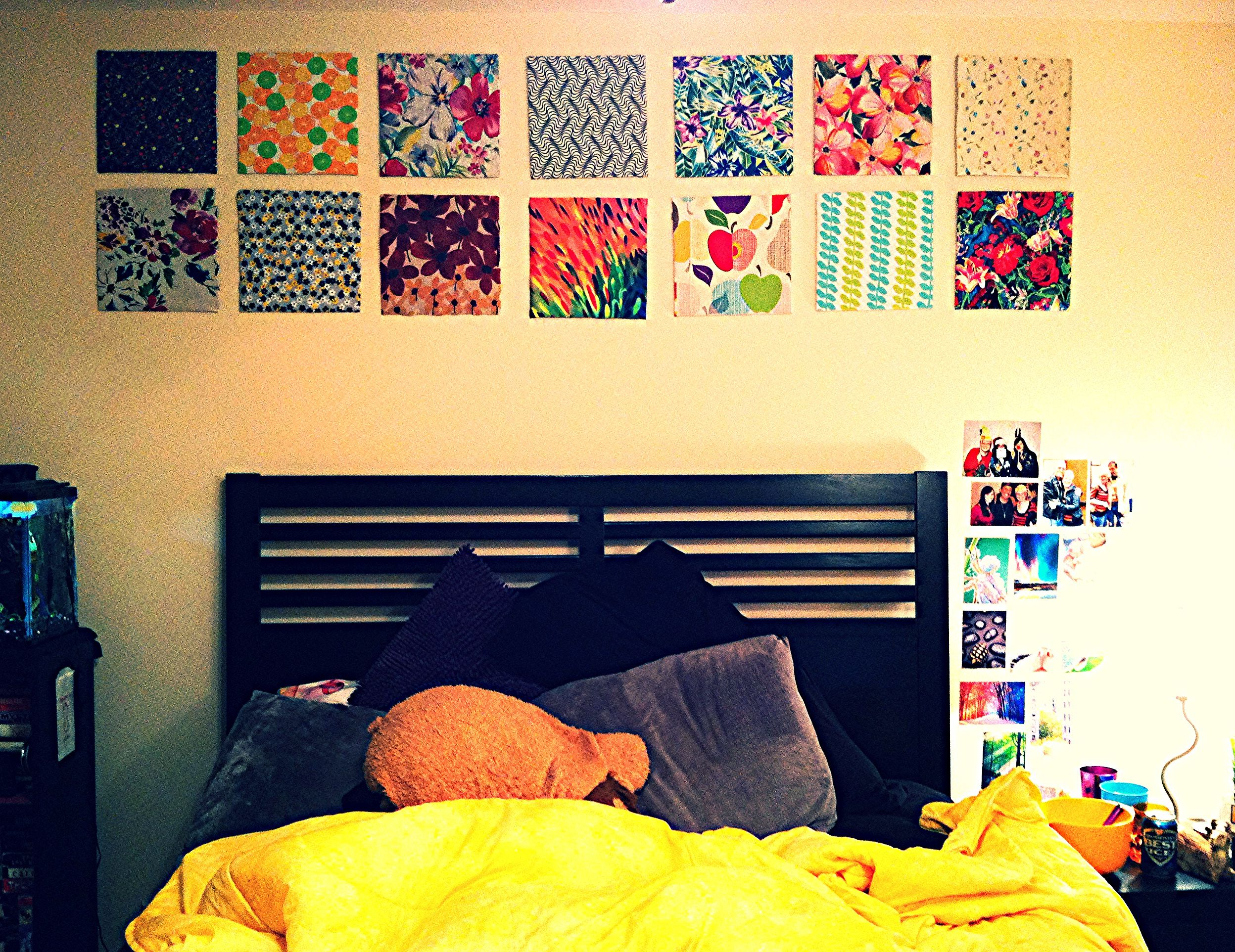 Fabric covered cardboard squares of mismatched prints as wall decor ...
