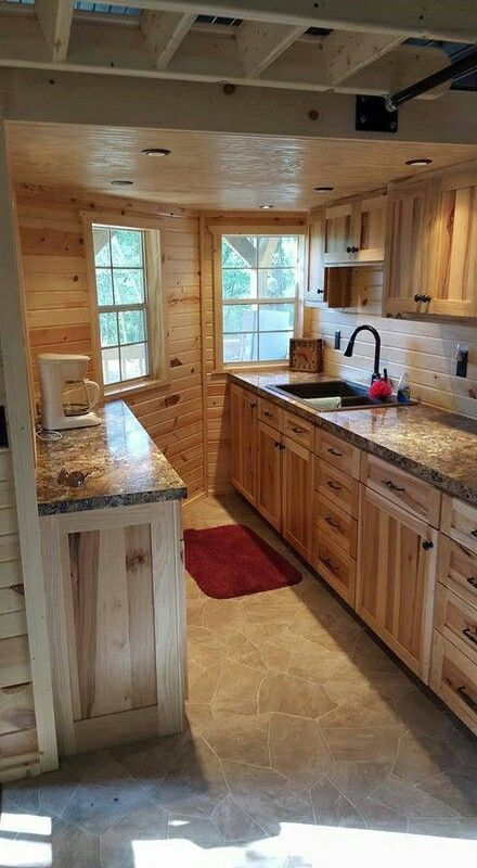 Maximize the space of graceland 39 s 14x40 wraparound lofted for Lofted barn cabin plans