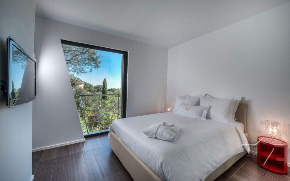 Exclusive Villa Holiday with Uninterrupted Views: Unique Architectural Bedroom With Trapezoidal Door Completed In Minimalist Interior Design...