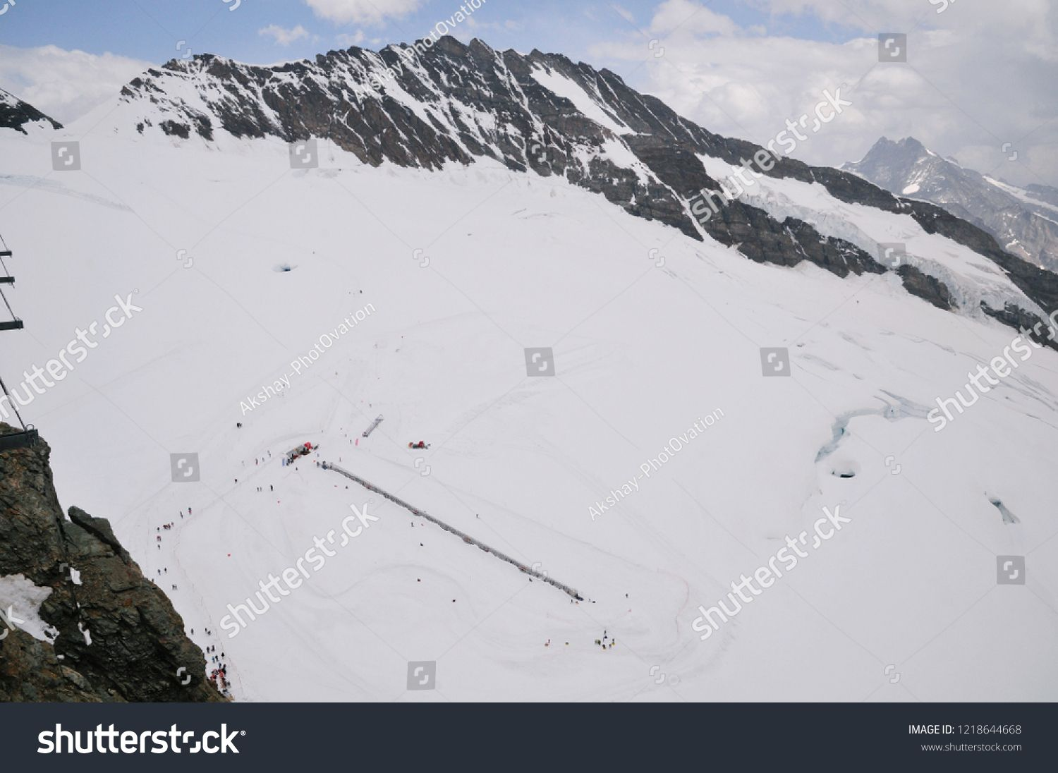Adventure and recreational sports in Switzerland Rare Bird eye or uaerial view of people enjoying winter sports on European alps at top of the europe jungfraujoch