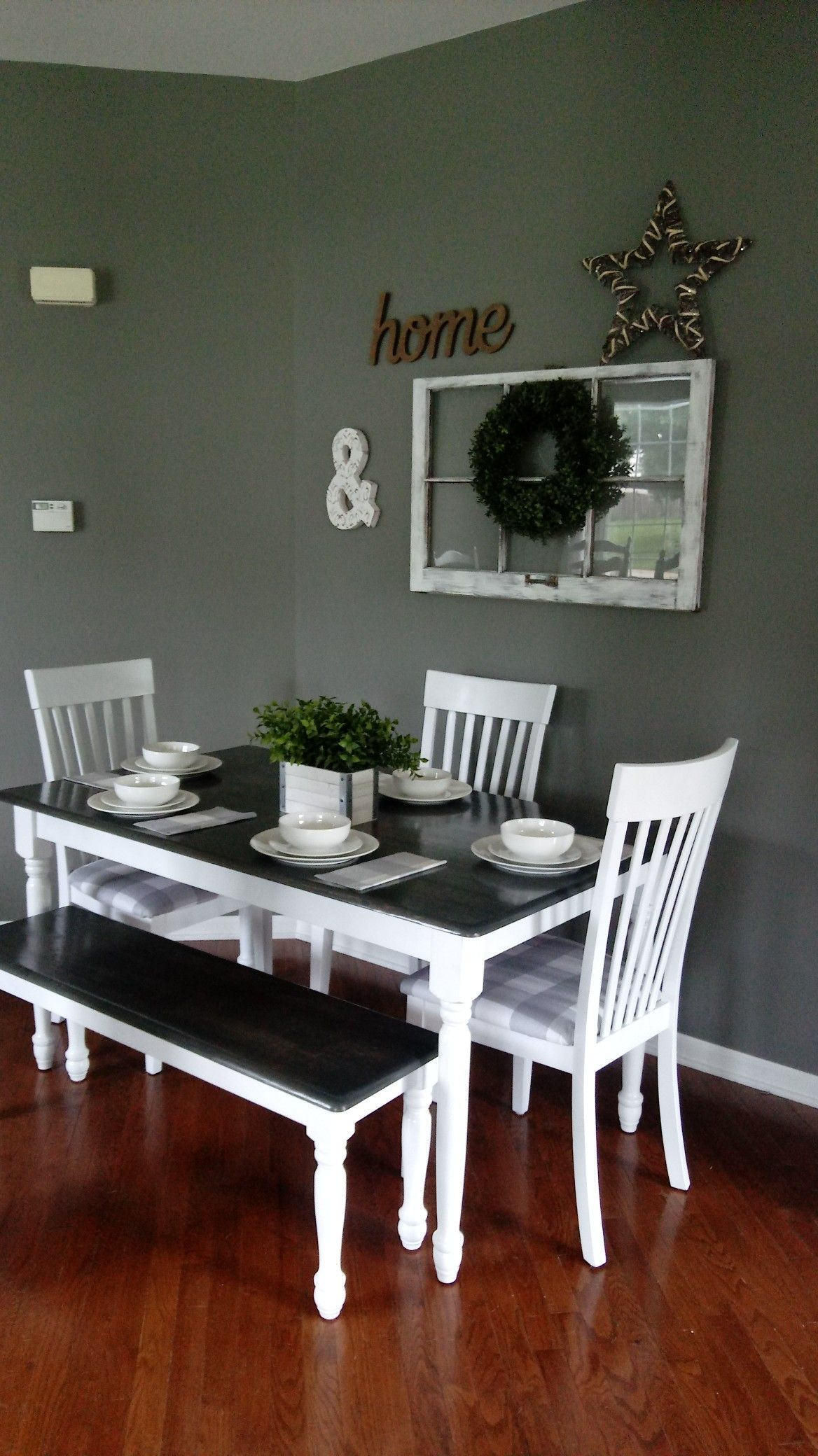 Gray and white farmhouse table with bench and buffalo