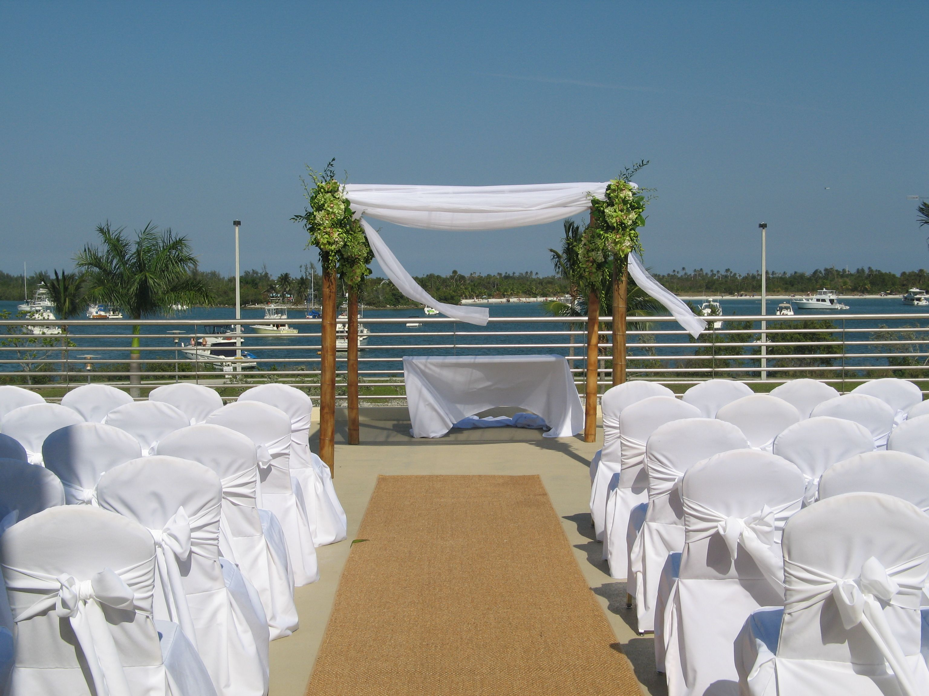 Beautiful beach wedding with a white organza canopy flowers and décor by Avant-Gardens & Beautiful beach wedding with a white organza canopy flowers and ...
