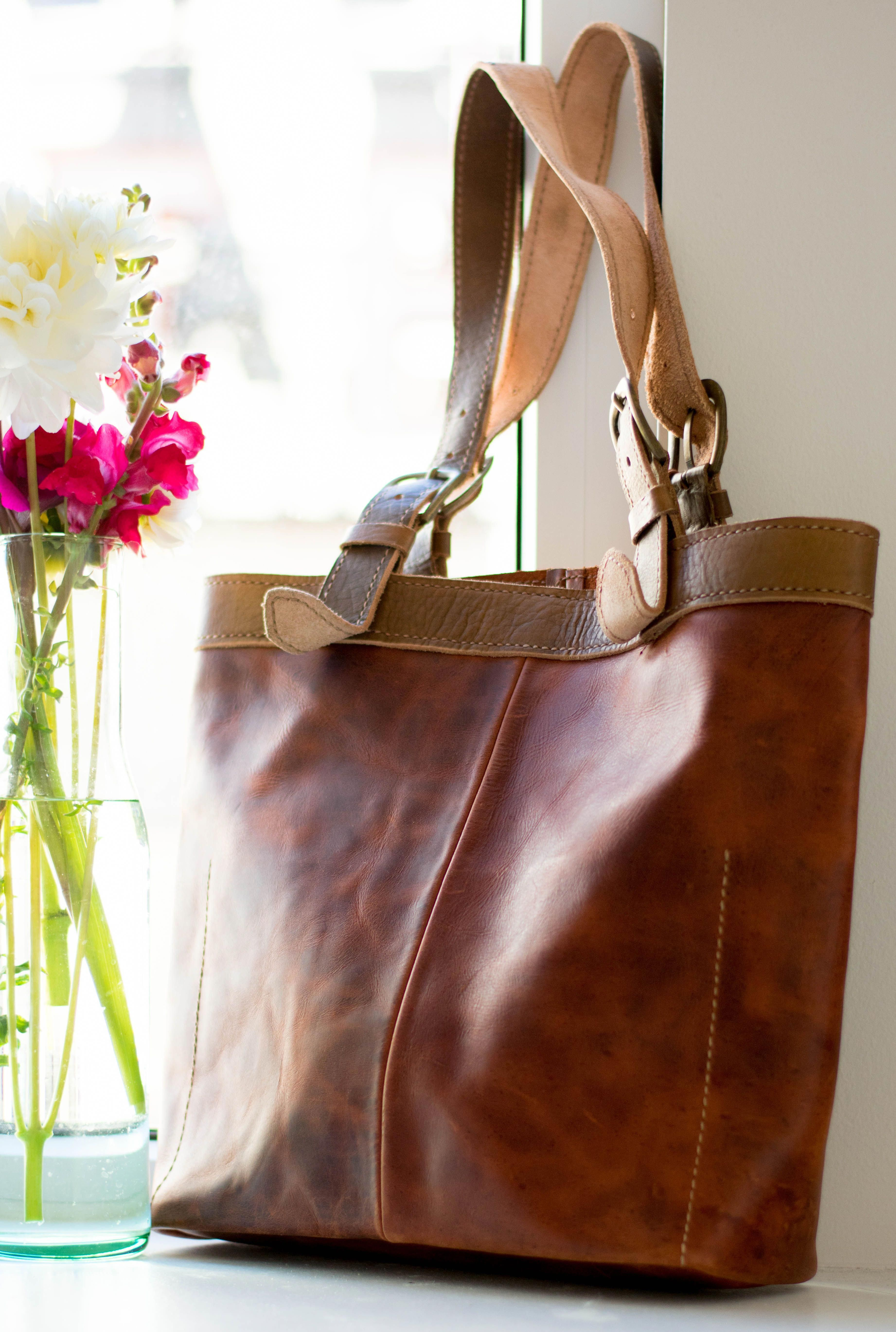 This beautiful leather tote bag is ethically made and provides sustainable employment opportunities to developing communities in Haiti  Honduras Wear this bag with a purp...