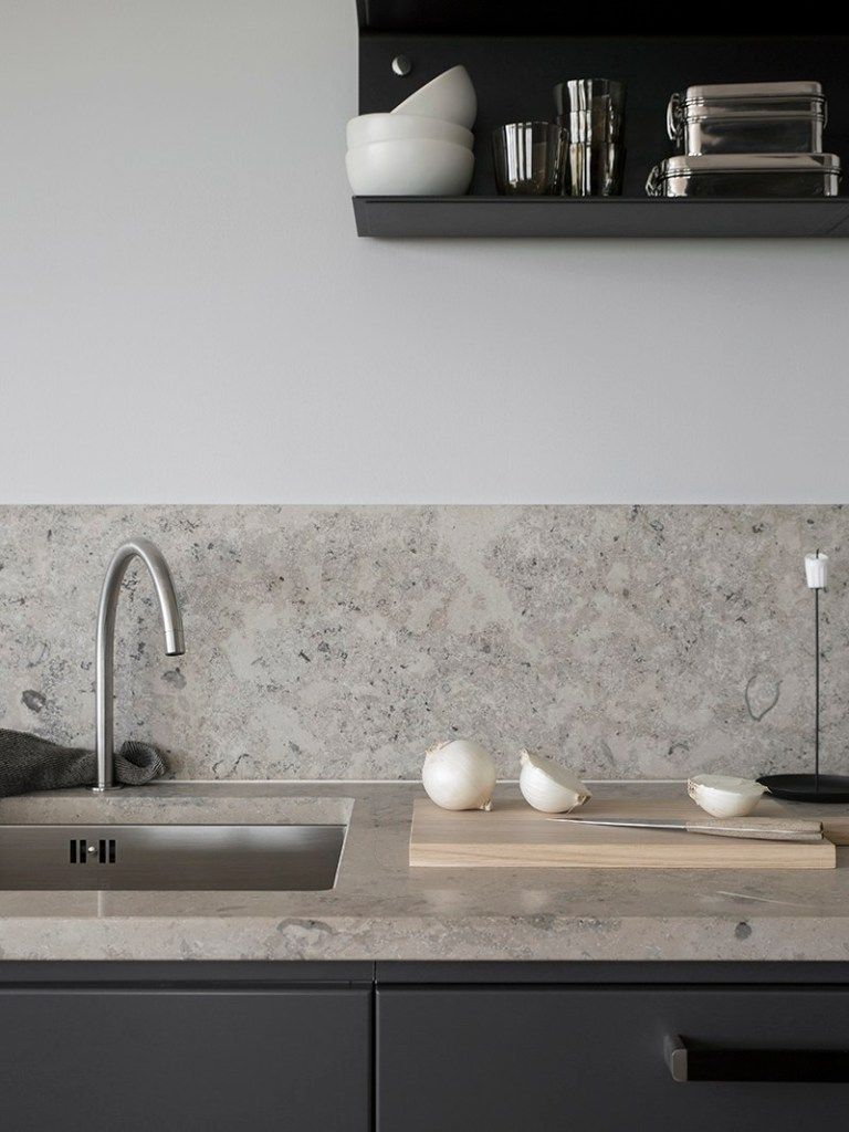 Dark grey kitchen with a natural stone top