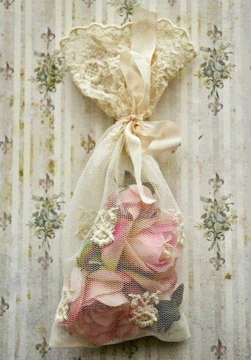 Pretty Dried Rose Buds In A Lace Bag