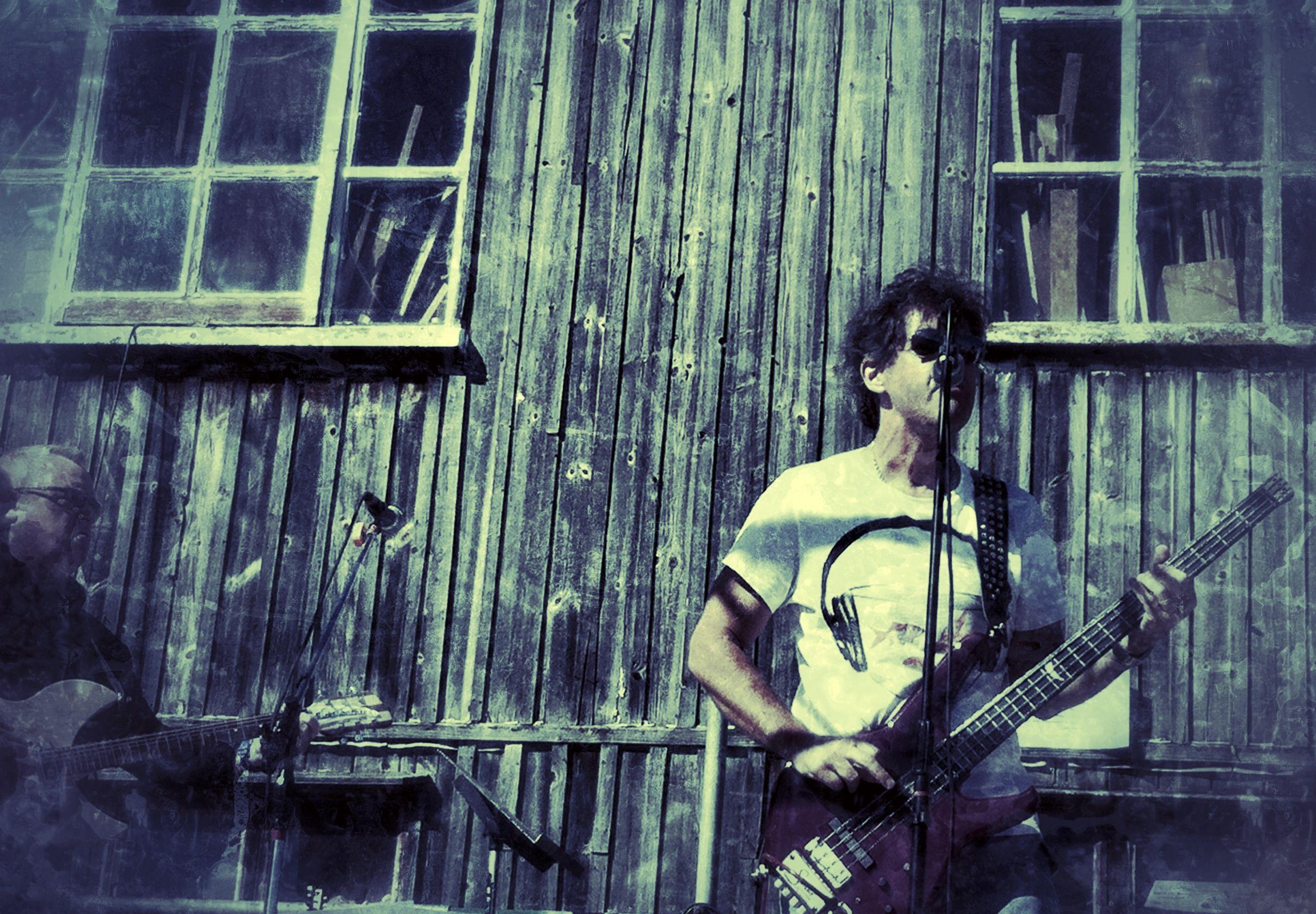 My husband playing bass!  Photo by Linda Hobden