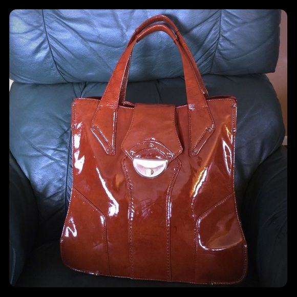 Like new Botkier tote Like new Botkier tote color brown in excellent condition, no rip, no tear, no scratches. Has 3 compartments on the inside and one on the back see pictures. Botkier Bags Totes