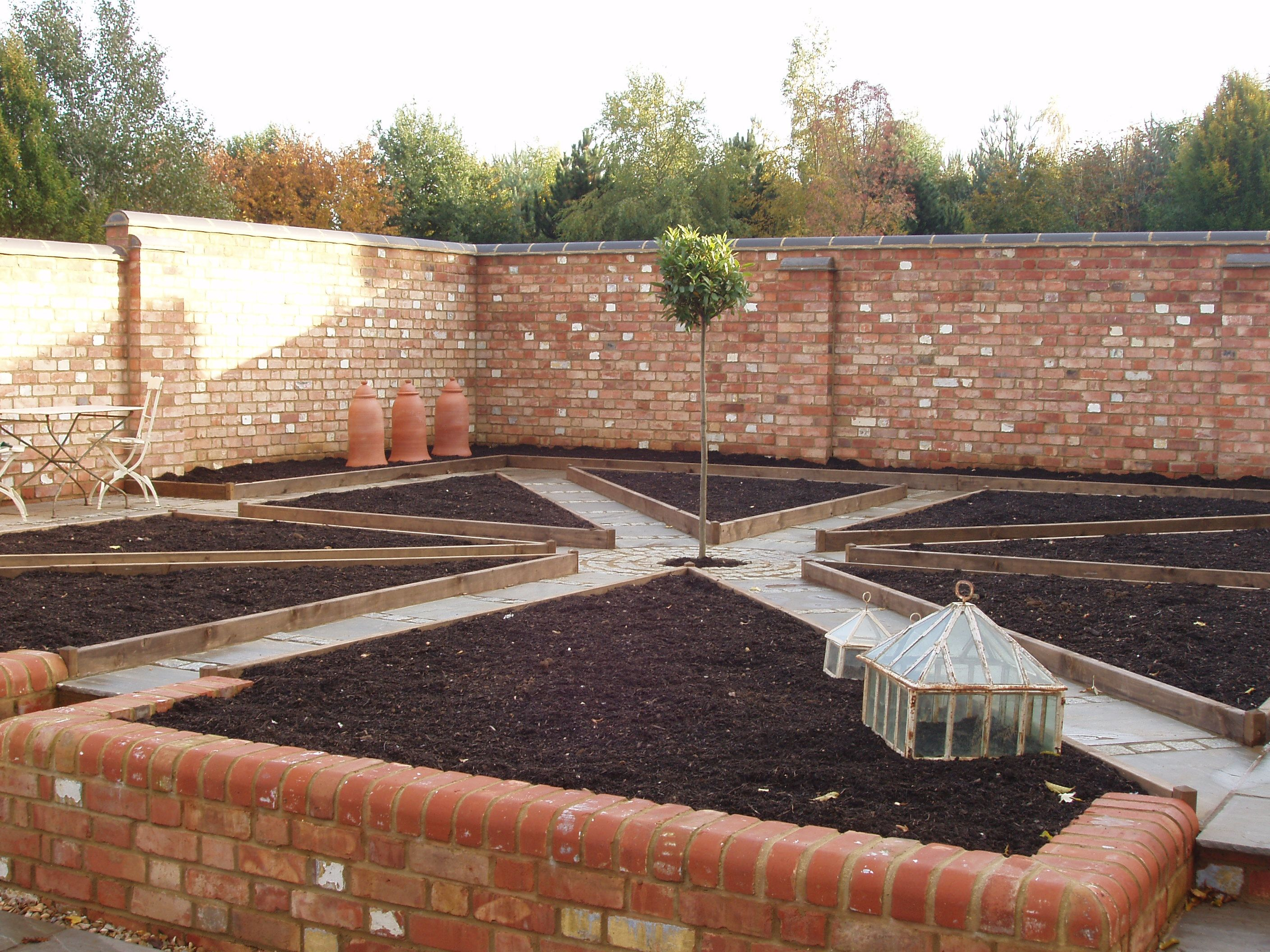 A Productive Walled Kitchen Garden Can You Imagine Walking The Paths With The Planters Full Of Herbs Or Fragrant Flow Kitchen Garden Garden Wall Garden Layout