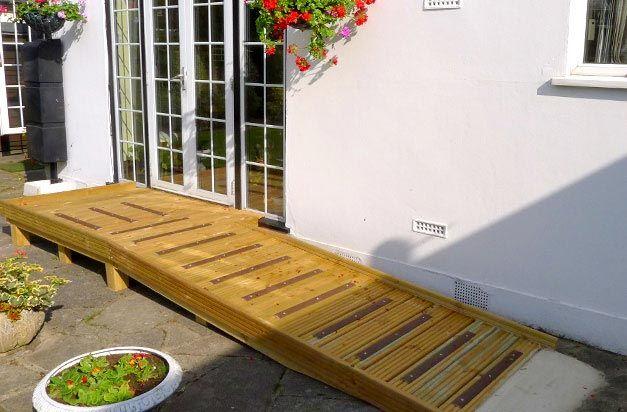 Wooden Ramp Access Platform With Non Slip Decking Strip Areas.