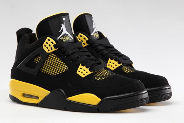 official photos 13ac3 8820f Jordan 4 Retro Thunder Black Yellow leather-and-synthetic Padded collar and  tongue for ankle support Cushioned midsole for comfort Rubber outsole for  ...