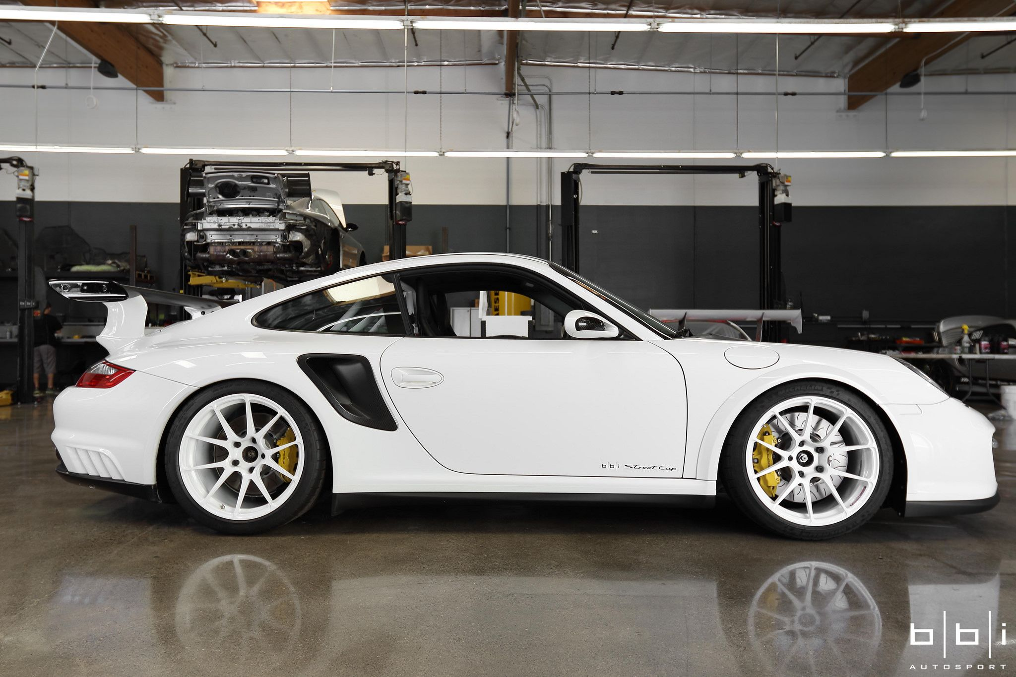 "What kind of visceral ultimate sportscar can you build, when budget is no obstacle? Maybe something like this incredible ""Project Swan"" Porsche 911 Turbo by our friends at BBi Autosport. This wild machine started as a 997.1 Turbo, but received a full rear wheel drive GT2 conversion. It's equipped with a 600+rwhp 3.8L and 19x10/19x12 Forgeline one piece forged monoblock GA1R Open Lug wheels finished in Super Wet White! See more at: http://www.forgeline.com/customer_gallery_view.php?cvk=1829"