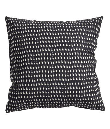 Cushion cover from h&m living. FilliIng can be bought at Ikea. Inexpensive!