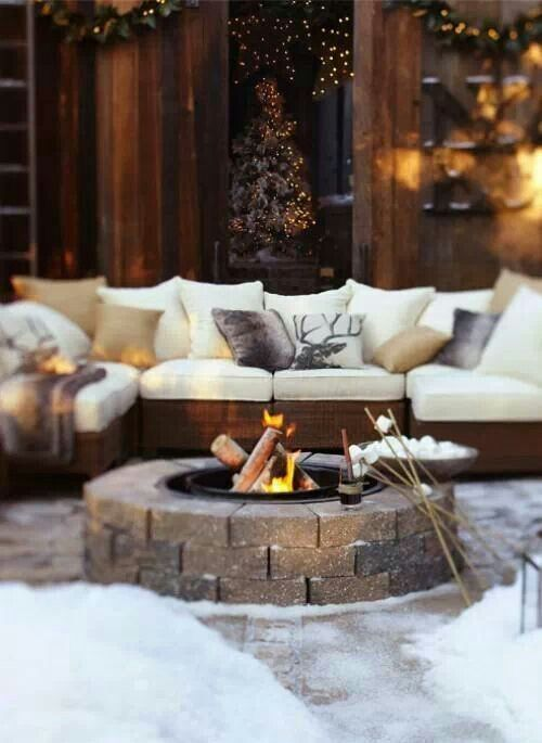 lounge outside with a cozy fire. Love this-- but also love the neutrals, warm fabrics and cozy feel.