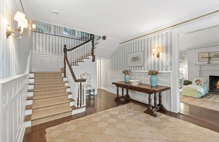 A grand staircase greets visitors in the entry.