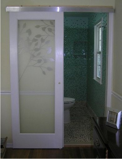 Bathroom Doors claremont glass door hung with modern barn door style hardware