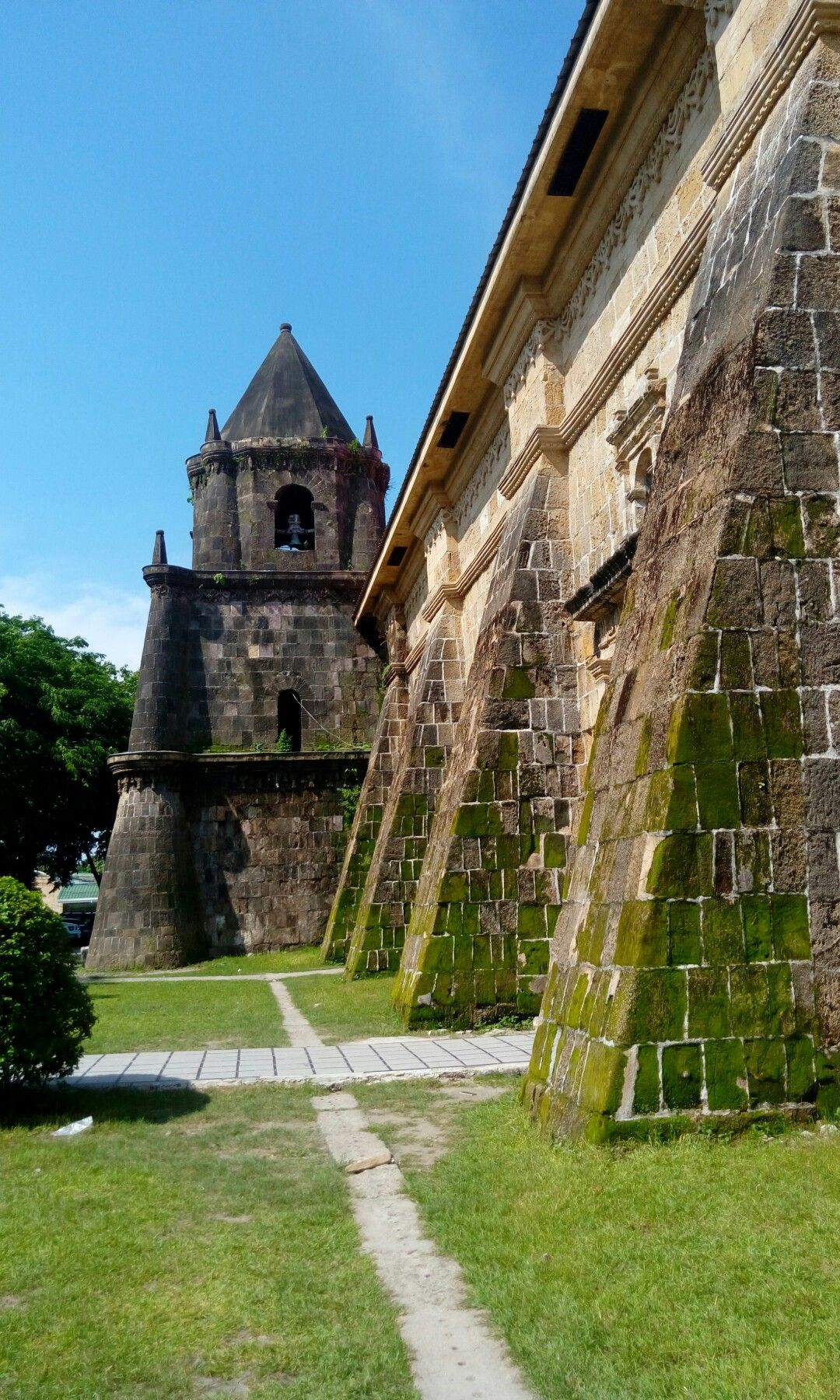 Side view of the Miagao Church also known as Miagao Fortress Church was completed in 1797 in Miagao, Iloilo. It is one of the oldest churches in the Philippines. It is a baroque romanesque style architecture with 1.5 meters thick walls that served as fortress from Muslim raids. Photo taken last July 17, 2016 using my HTC phone.