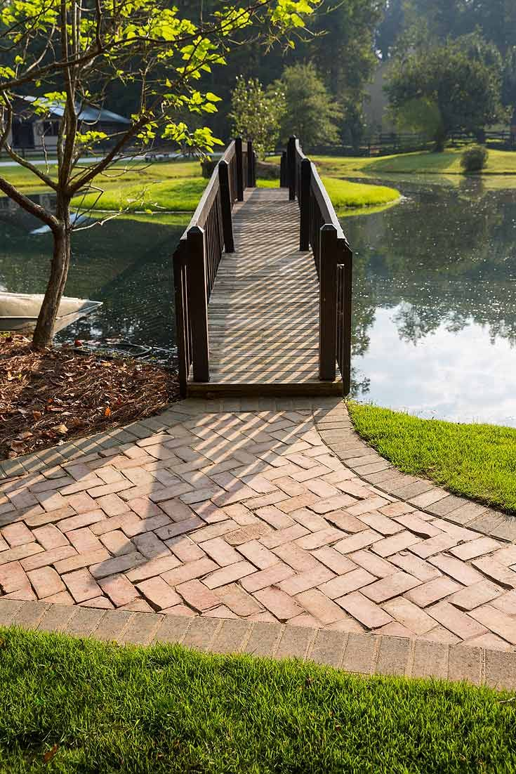 Installed in a herringbone bond, the pavers reflect the natural essence of the the sprawling countryside that surrounds the property.