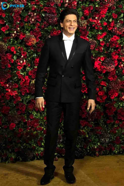 Shahrukh Khan in black blazer at DeepVeer Reception party