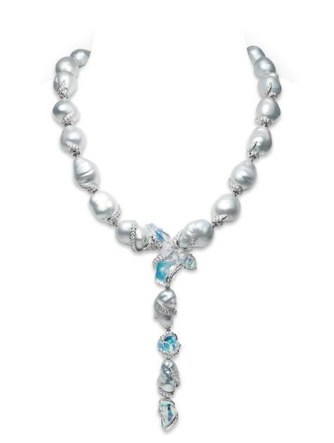 Opal Baroque Couture Necklace  Magnificent, one-of-a-kind lariat necklace featuring 17x13mm baroque White South Sea cultured pearls with 37.11cts. of oversized opals and 10.14cts.of pavè diamonds in vine-like swirls, set in 18k white gold.