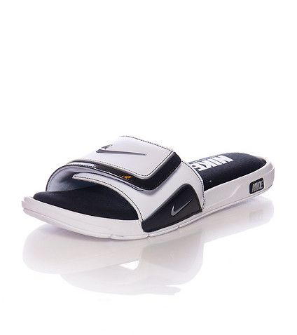 673c0b20165d NIKE Comfortable slide on sandal Velcro strap closure with NIKE swoosh logo  Cushioned memory gel inner sole for ultimate comfort