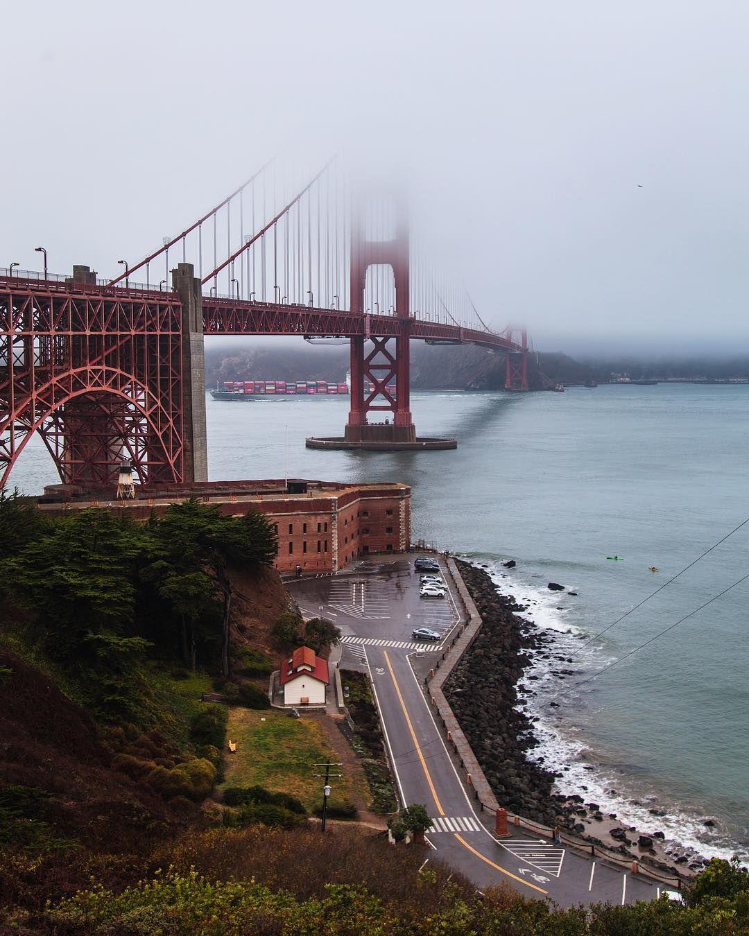 The Beautiful Golden Gate Bridge In The Rain Under A Blanket Of