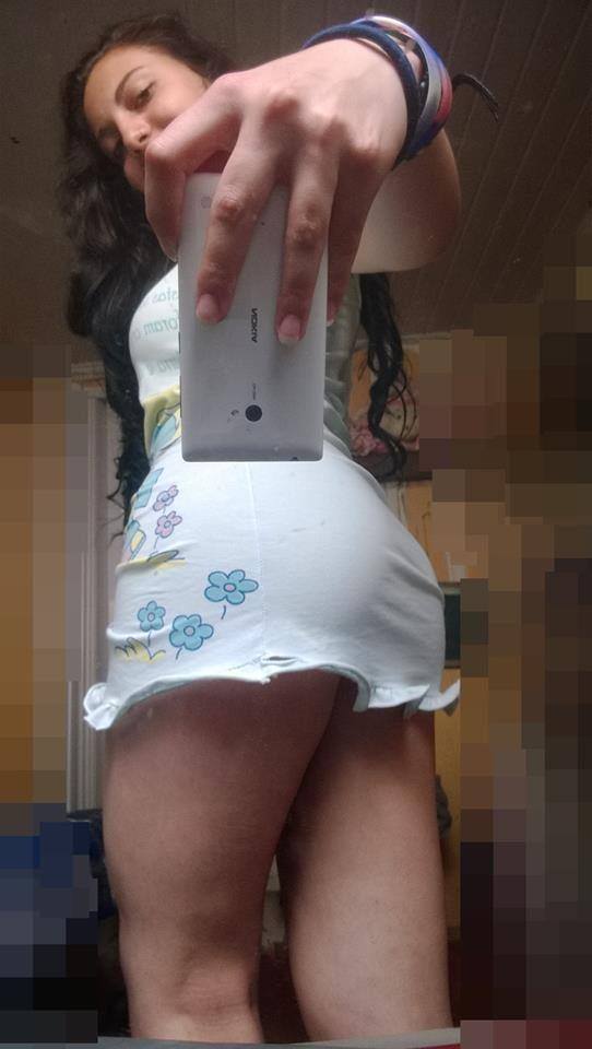 latina in short skirt