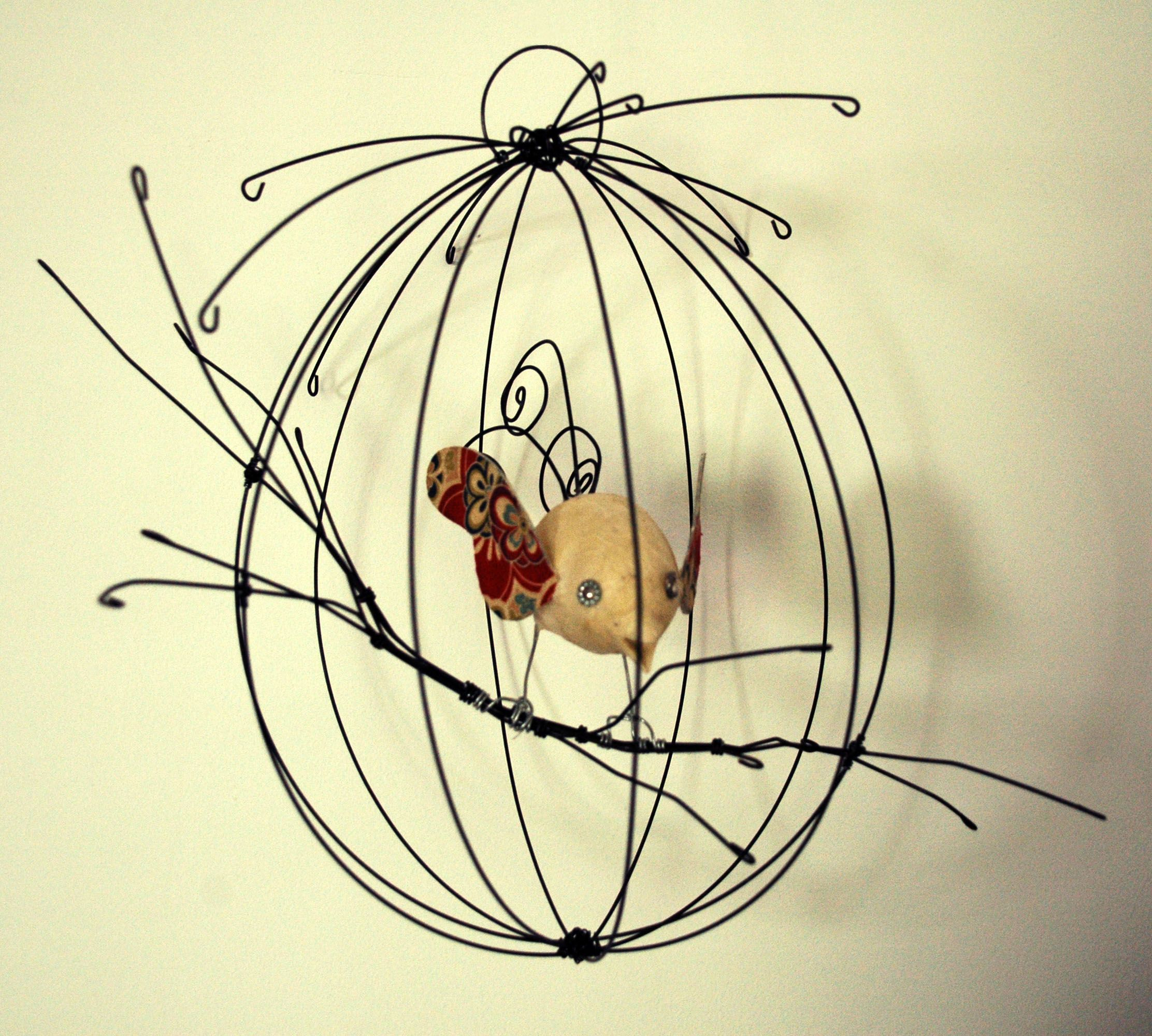 bird cage in wire - would look nice on wall with a crocheted bird ...