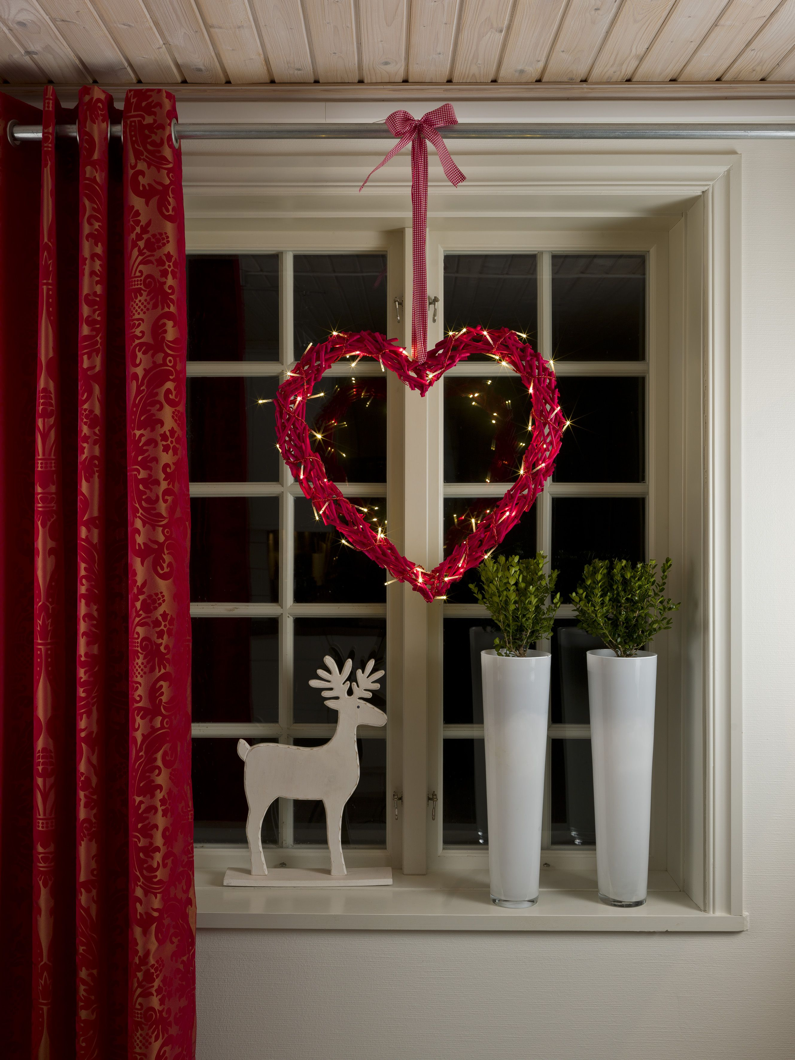 brighten up your window this christmas with this handmade lit heart painted in red