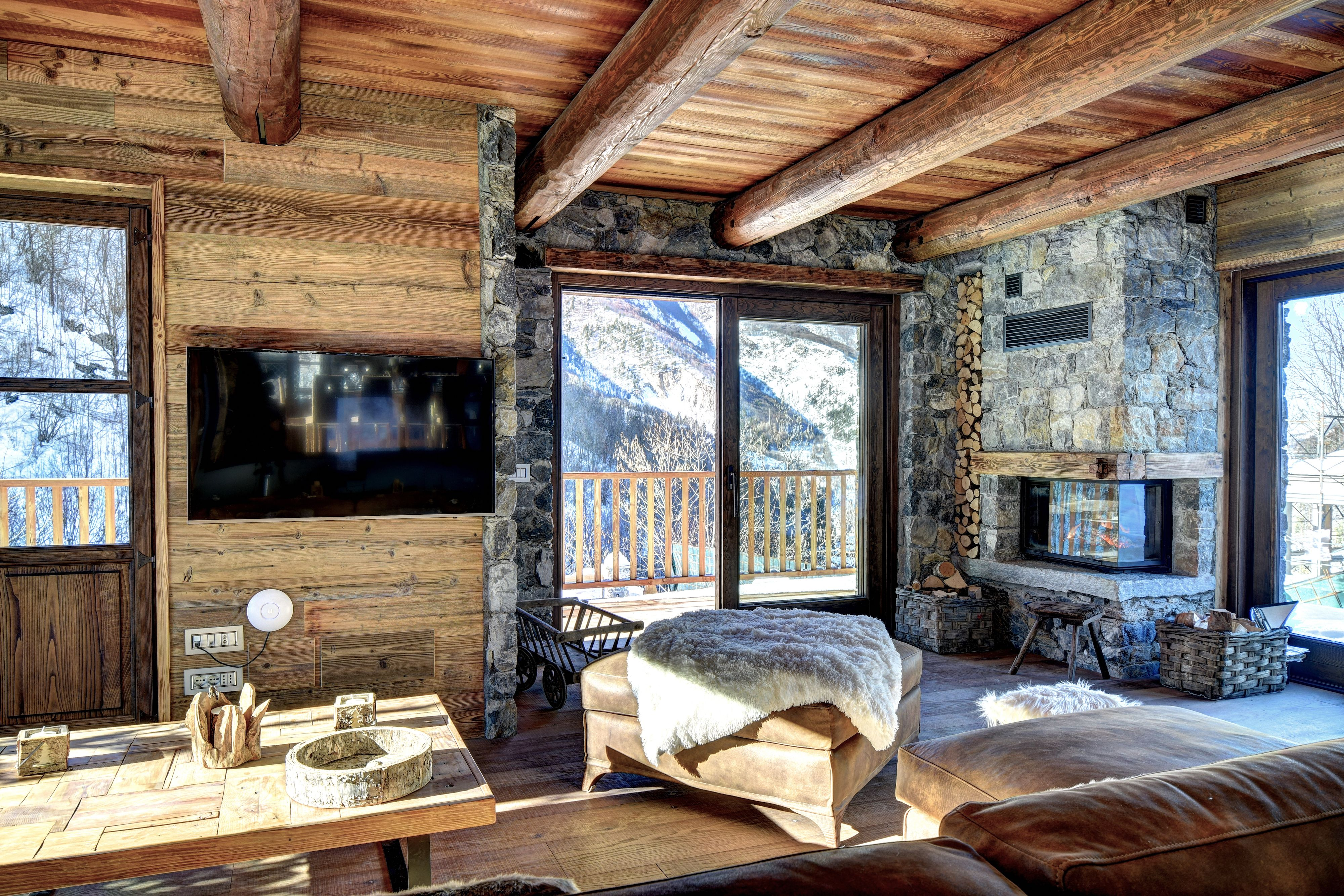 Ski chalet furniture Cabin Ski Chalet Living Room With Leather Sofa Fireplace Wooden Floor And Furniture Stone Details Windows With Amazing View On The Slopes Charis White Interiors Ski Chalet Living Room With Leather Sofa Fireplace Wooden Floor