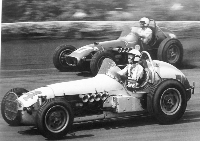 mario andretti races under bobby marshman at langhorne 1964 look how high their heads are in. Black Bedroom Furniture Sets. Home Design Ideas