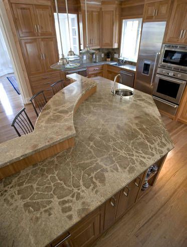 Huge Two Level Kitchen Island With Nice Curvy Shapes And Tall
