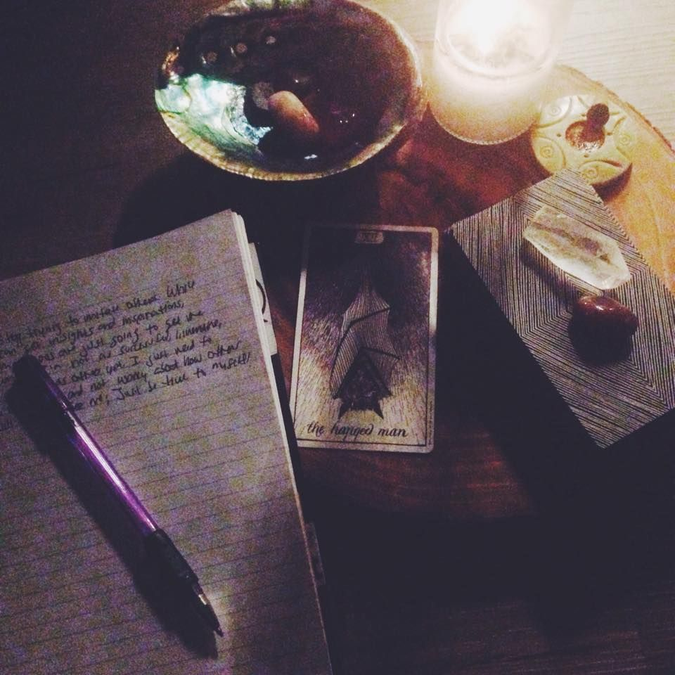 The Wild Unknown Tarot Cards- Hanged Man, journaling, crystals and candle light. Ashes and Wine Tarot