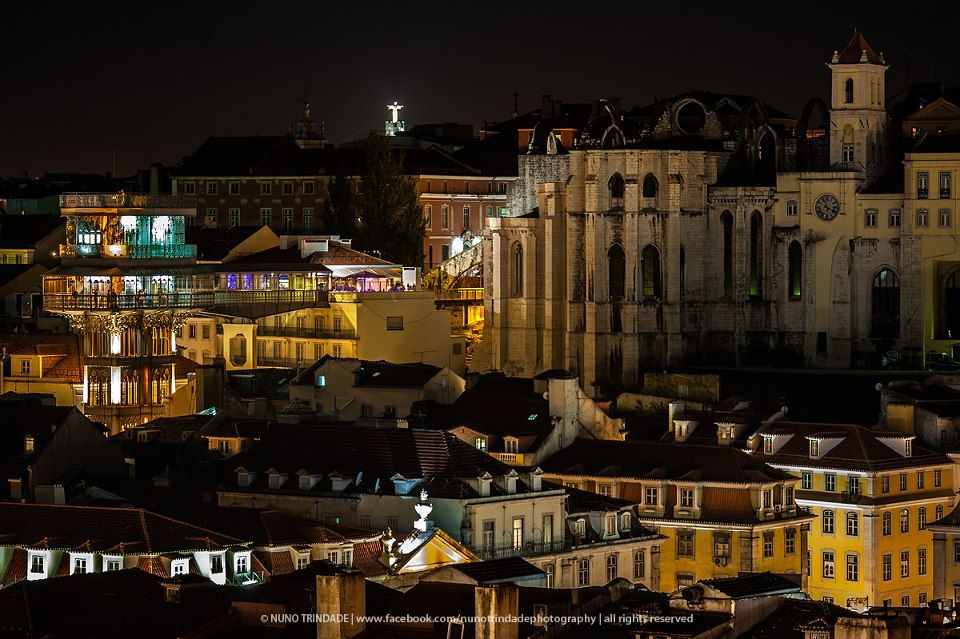 Downtown Lisbon, on the left the Santa Justa Elevator, on the right the Carmo Convent ruins, on the horizon, the statue of Christ the King, on the south bank of the river Tagus  www.facebook.com/nunotrindadephotography