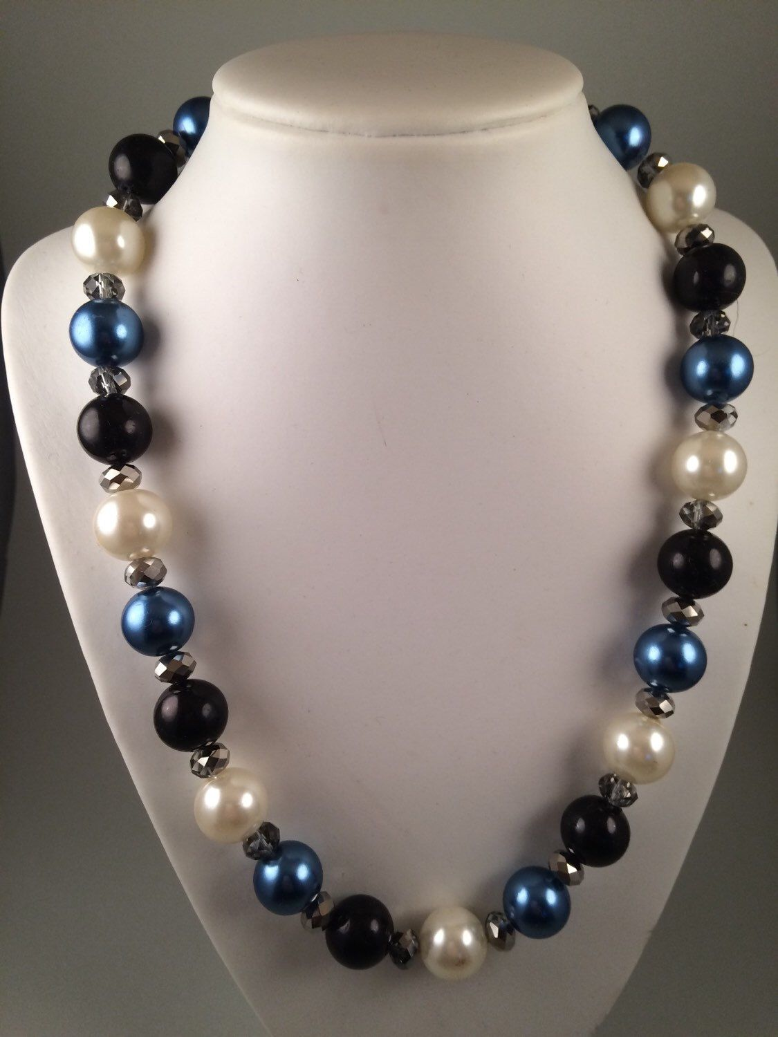 A personal favourite from my Etsy shop https://www.etsy.com/au/listing/384735218/blue-black-and-cream-glass-pearl