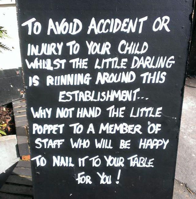 Is this funny? Pub sign offers to nail kids to the table