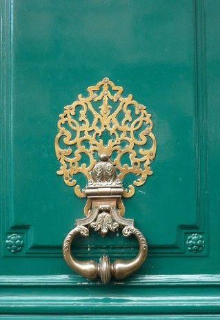 Attractive Brass Knocker On Beautiful Green Door.