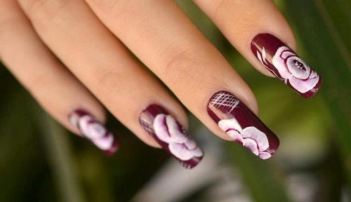 A real cute nail design, pink with small white roses