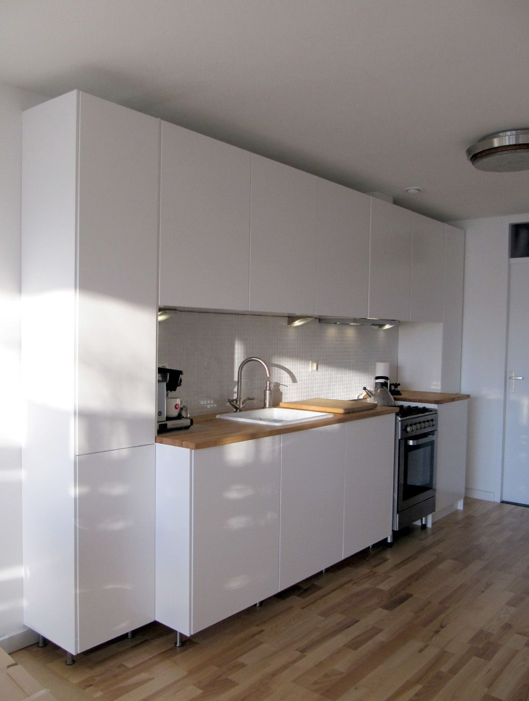 scandinavian interior design; ikea kitchen with veddinge doors in an