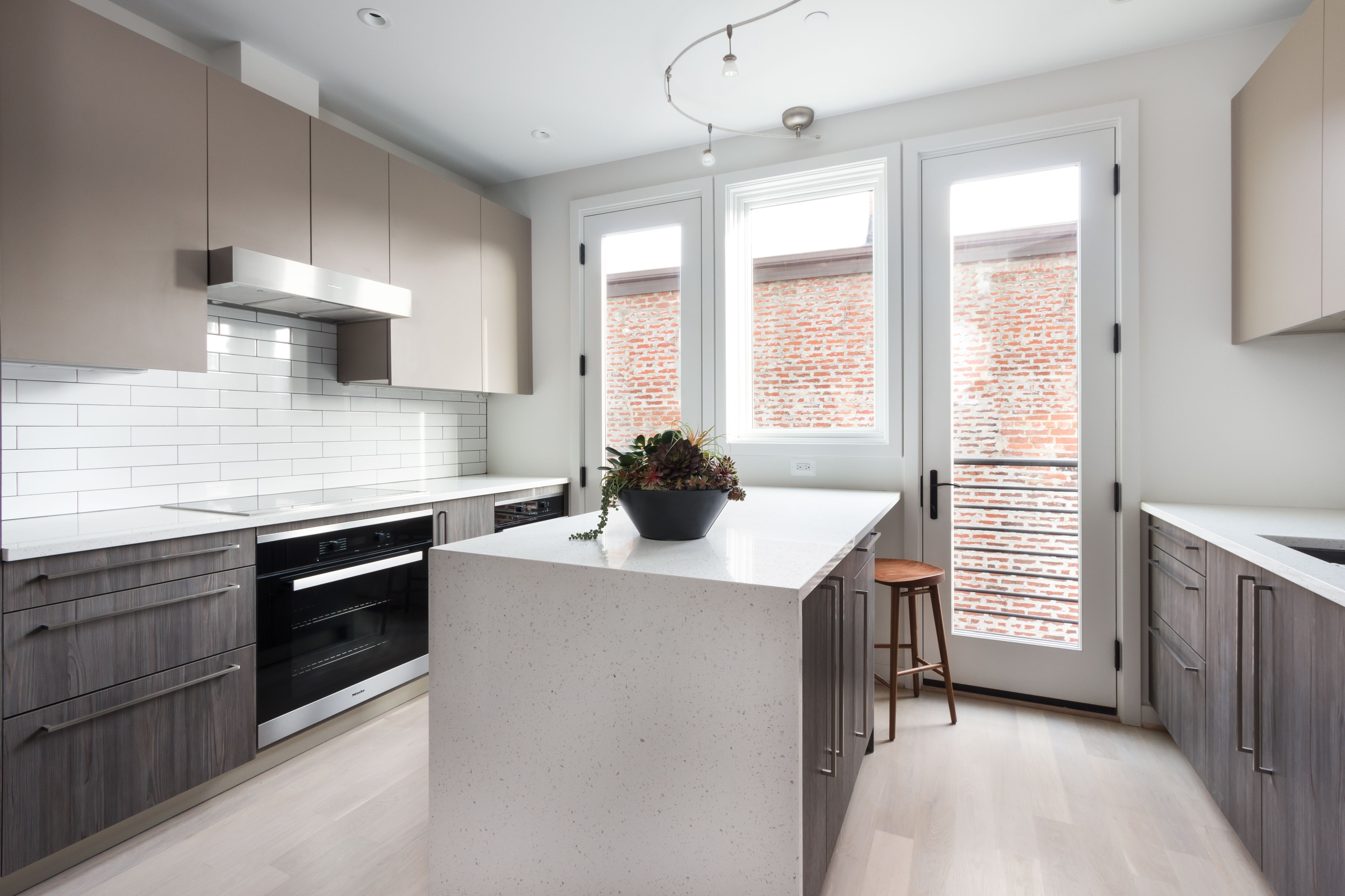 The Towns At Linden Court In Washington D C Snaidero Cabinetry Code Tundra Elm And Cappuccino Matte Melamine Kitchen Design Kitchen Cabinetry Cabinetry