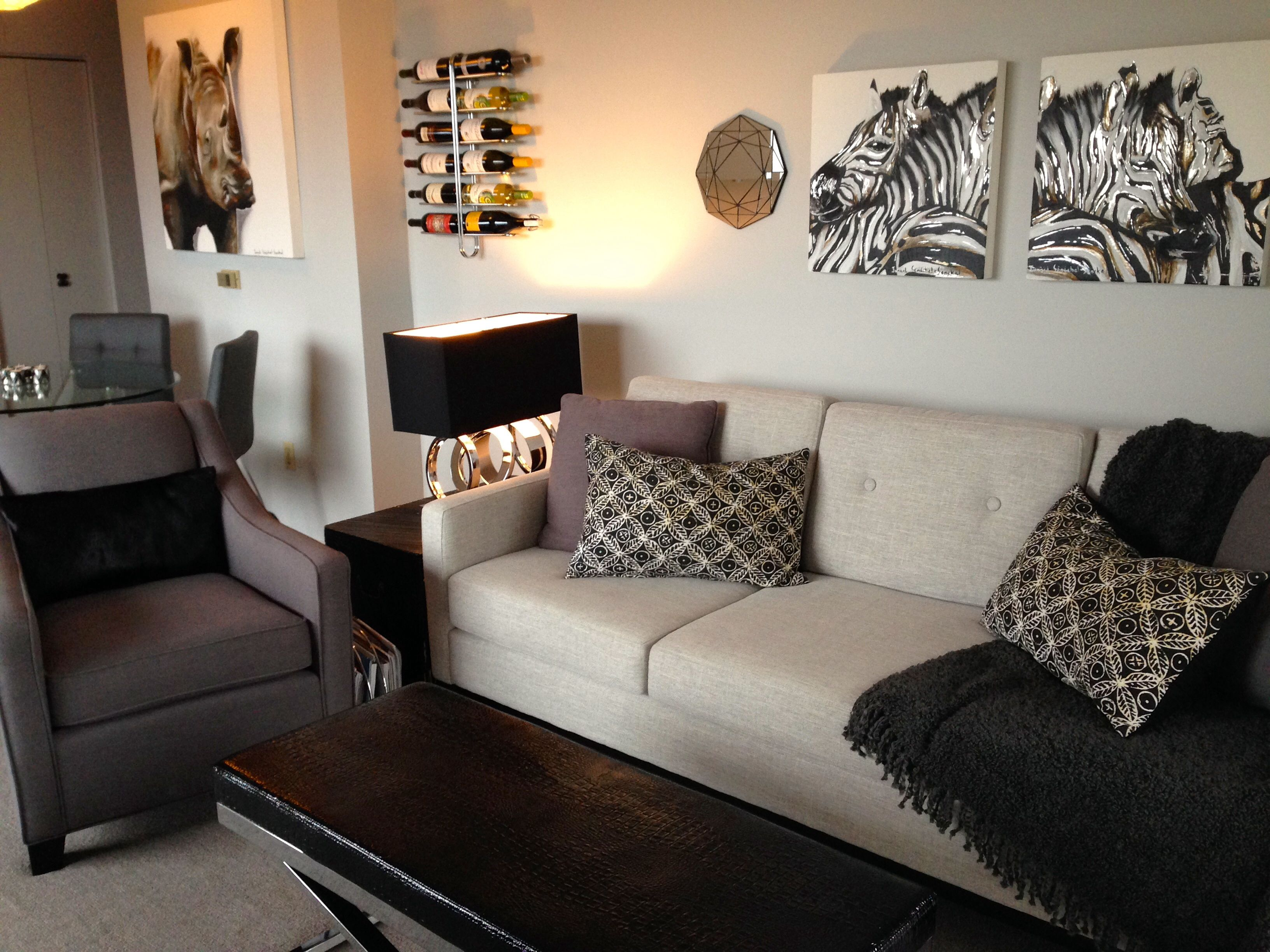 safari african-inspired living room with leather couch and double