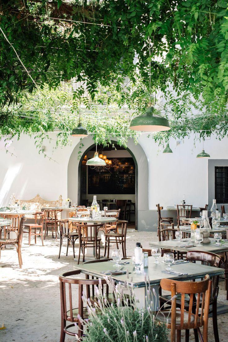 Outdoor restaurant design with hanging trees and a tropical feel. El Portalon, Dalt Vila, Ibiza